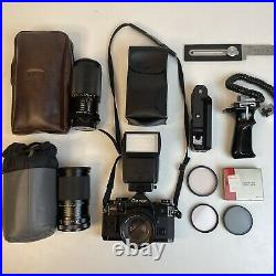 Canon A-1 35mm SLR Film Camera with Lenses Filters & Vintage Leather Carrying Case