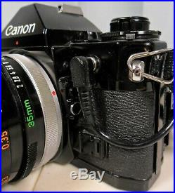 Canon A-1 SLR Camera With Leather Case, Data Back, 35mm Lens, Grip & New Battery