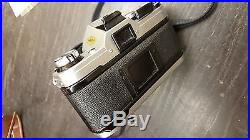 Canon Ae-1 Slr Camera With 50mm & 70-210mm Zoom Lenses In Leather Case