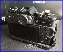 Fujifilm X-T20 camera BODY ONLY with Fuji leather half case Superb