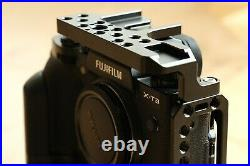 Fujifilm X-T3 camera with battery grip, leather half-case and SmallRig half-cage