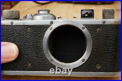 Leica Standard (Model E) screwmount film camera, body only with a leather case
