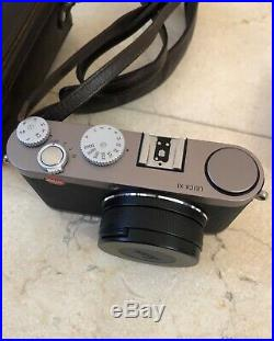 Leica X1 12.2MP Digital Camera with Brown Leather Case and extra battery