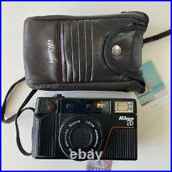 Nikon L35AD2 35mm Point and Shoot Film Camera and Leather Case