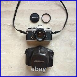 Olympus OM1n 35mm SLR Film Camera with 50mm f1.8 Lens, Strap, Caps + Leather Case