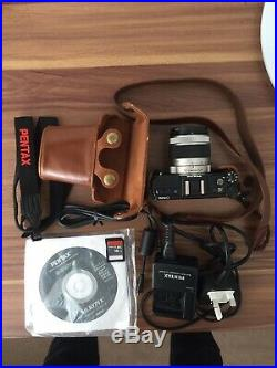 Pentax Q Camera With Leather Case, 02 Standard Zoom, Spare Strap, Charging Cable