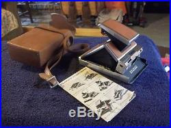 Polaroid SX-70 Land Camera with classic brown leather cover and case nice shape
