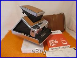 Polaroid SX 70 Land camera, with leather case and 1 film, top and as new, Silver