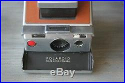 Polaroid SX-70 with leather case instant camera