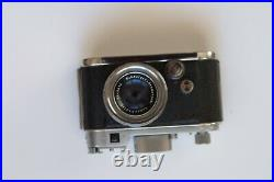 Robot 35mm Camera with Schneider Xenon f1.9 40mm lens and leather case