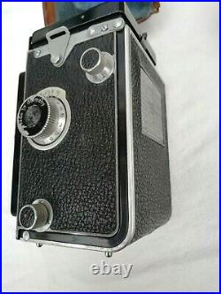 Rolleiflex Camera in Leather Case with Box of Extra Parts