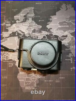 SONY DSC-RX100M5A CAMERA with leather case and handle