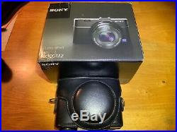 Sony Cyber-shot DSC-RX100 M2 MK II Camera and leather case