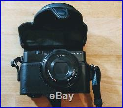 Sony Cyber-shot RX100 II 20.2MP Digital Camera with official leather case