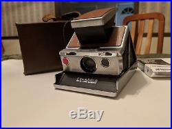 Vintage Polaroid SX-70 Land Camera Brown Leather with Case and color film. Exc